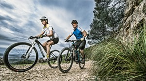 Suunto cyclists mountain biking with their sports watches