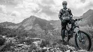 Suunto mountain biker high in the mountains in black and white